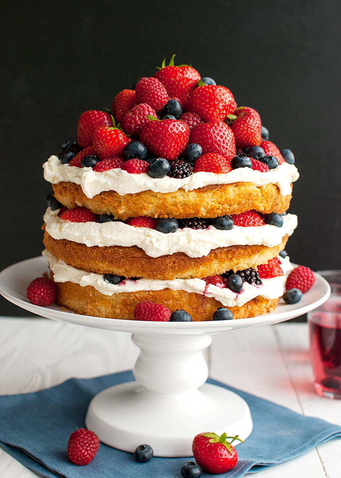 Forest Fruit Cake with Stabilized Whipped Cream Frosting - the whipped cream frosting is light and fluffy and creamy but holds it shape for days! | thetoughcookie.com