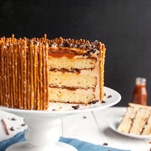 Salted Caramel Pretzel Cake - To die for! | thetoughcookie.com