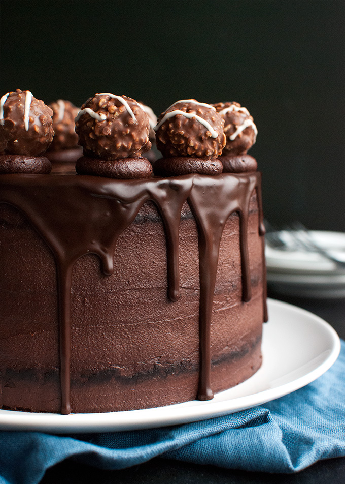 Triple Dark Chocolate Cake - chocolate cake, filled with the best dark chocolate buttercream and topped with chocolate ganache and truffles! | thetoughcookie.com