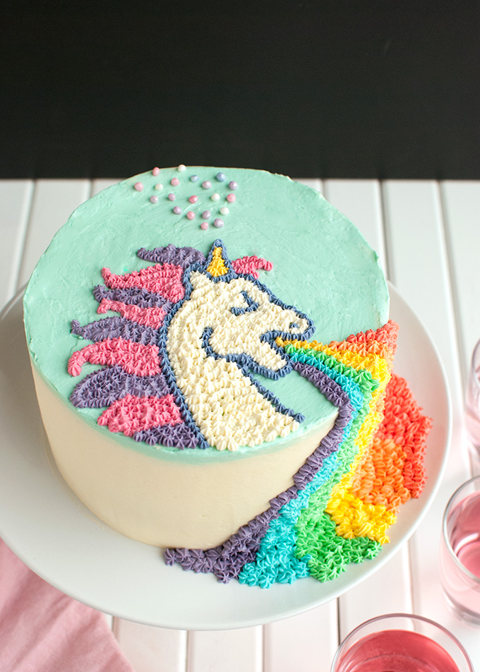 Puking Unicorn Cake - This cake is sooo much fun, and the buttercream design on top is pretty easy if you use a template! | thetoughcookie.com