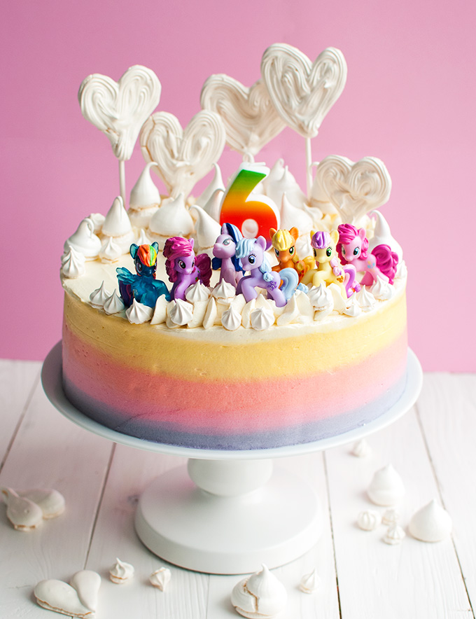 Super Cute My Little Pony Cake - This cake with My Little Pony figures and a rainbow is pretty easy to make at home compared to most My Little Pony cakes out there, but kids love it nonetheless! | thetoughcookie.com