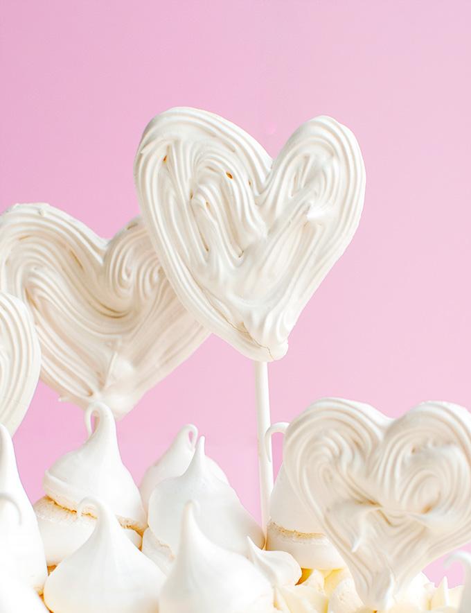 Fun Freehand Meringue Heart Pops - these make super cute cake toppes, too! | thetoughcookie.com