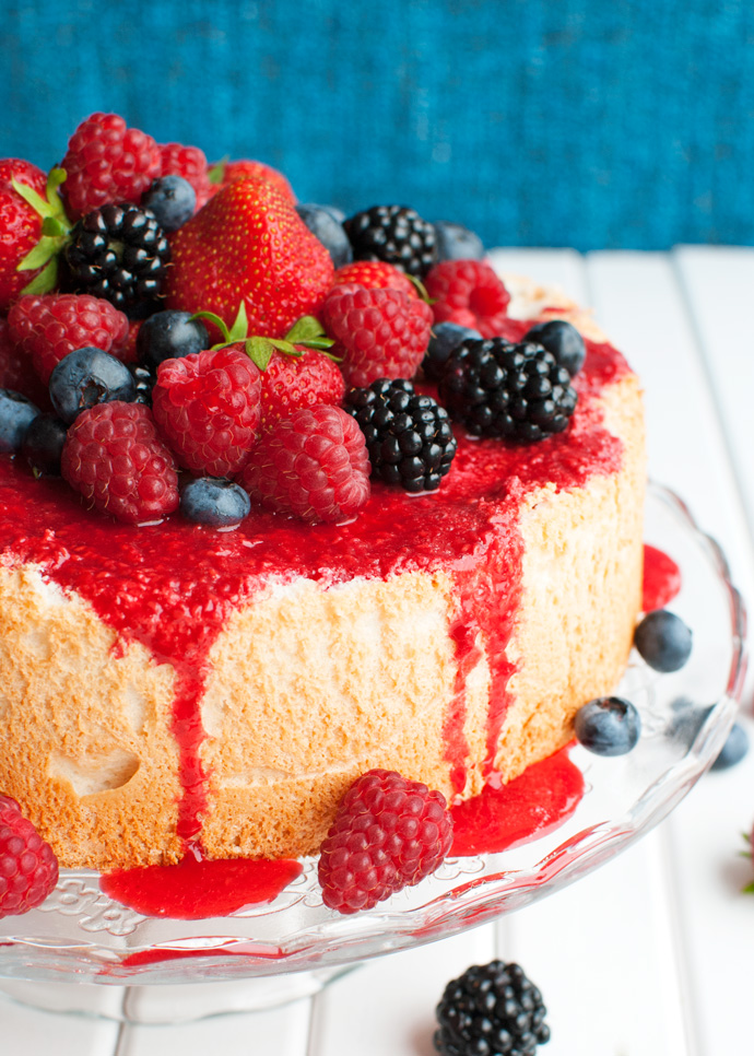 Perfect angel food cake with raspberry sauce and berries the tough the tough cookie perfect angel food cake thetoughcookie forumfinder