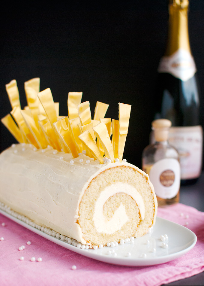 Champagne Cake Roll - Champagne cake, filled with Champagne buttercream, coated in white chocolate ganache, and topped with amazing white chocolate shards. Impress your guests! | thetoughcookie.com