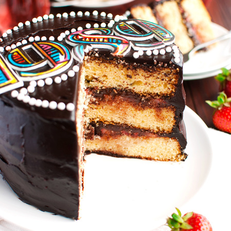 Vanilla Cake Filled with Juicy Strawberries and Super Dark Chocolate Frosting – AKA: The Taylor Swift 1989 Tour Cake