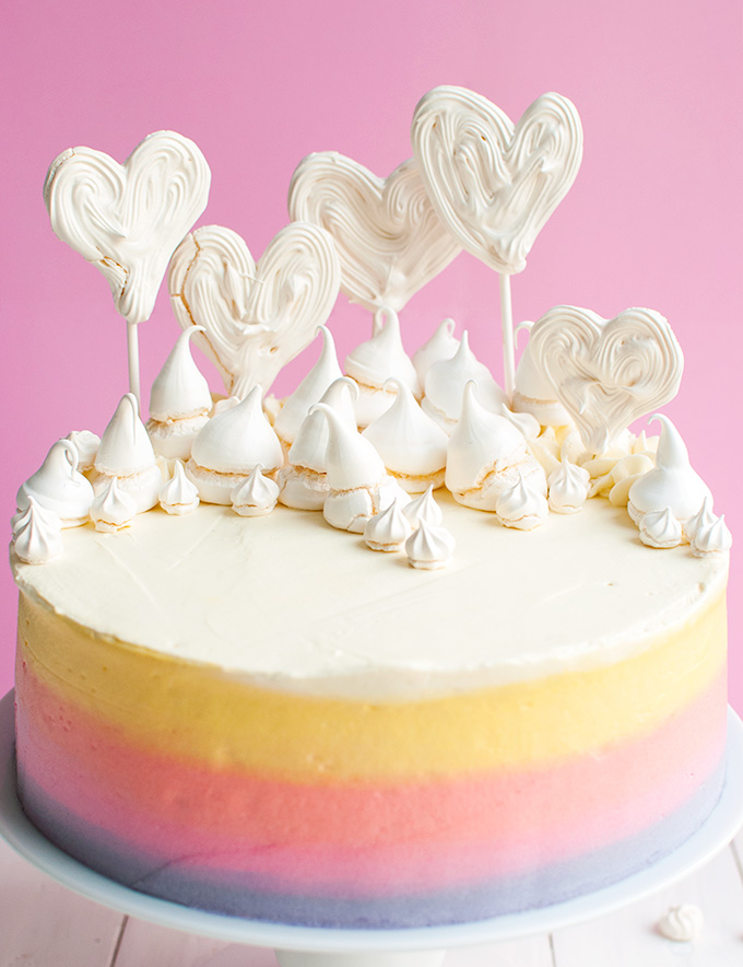 Pastel Rainbow Meringue Heart Cake | This delicious vanilla cakes makes the BEST birthday cake. It's big, fun and so delicious! Great for Valentine's Day, too! | thetoughcookie.com