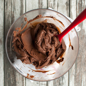 Dark Chocolate Crémeux, or the BEST chocolate frosting ever! It's super smooth, incredibly creamy and deliciously fudgy. And it has an intense chocolate flavor! | thetoughcookie.com